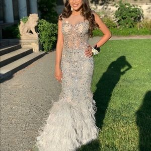 silver feathered mermaid style prom dress